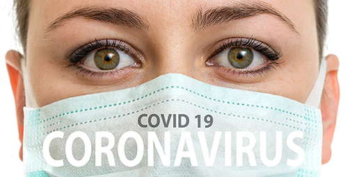 Close up of female nurse wearing mask with text Covid 19 Coronavirus on the mask